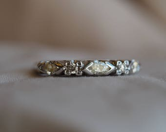 Very unique and beautiful vintage 14K white gold marquise diamond-set band