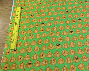 Toil and Trouble-Pumpkins on Green Cotton Fabric from Henry Glass
