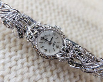 Small faced rodium plated and marcasite Victorian style Datex Swiss made mechanical watch