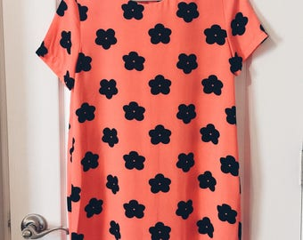 Daisy pattern dress in bright coral