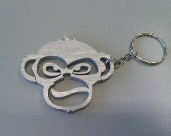 Scimmia arrabbiata, volto di scimpanzè stilizzato, portachiavi animali in alluminio