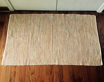handwoven rug  multifiber   synthetic  durable  reversible   peach