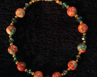 Red Tie-Dye Bead and Emerald Green Bracelet with Gold Spacers