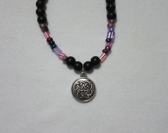 Black and purple beaded necklace with sterling silver charm pendant