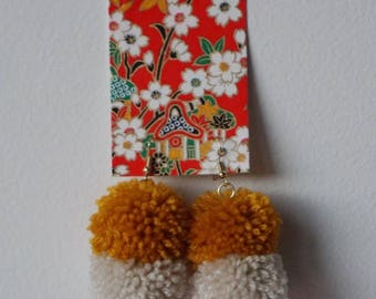 Handmade Yellow and White Pom Pom with Red Bead