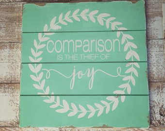 Comparison is the thief of joy 12x12 distressed rustic sign