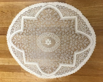 Beautiful antique cream doily/table mat