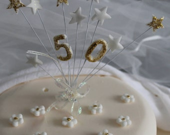 Golden wedding and crafted edible spray and sprinkles for celebration cakes