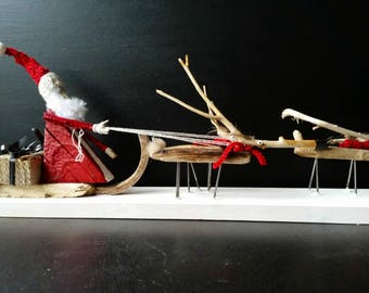 Santa Claus with his sleigh and reindeer drift wood