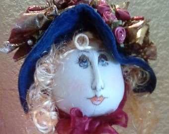 cloth doll head  // bonnet  with gold decoration //  fabric // ribbon chin sash // decorative // collectable
