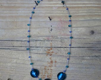 Blue glass floating bead necklace