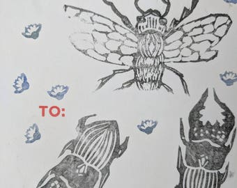 linocut sticker of bee and beetle (1of1)