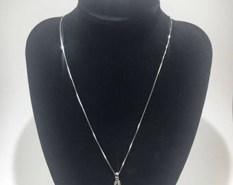 A pendent Silver chain