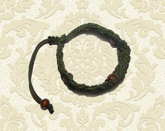 Bracelet made of waxed cord and wooden beads. Swamp green
