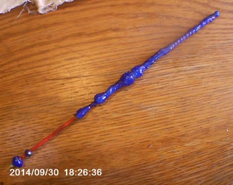 Blue and red handmade quill pen