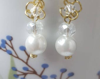 Handcrafted earrings with pearls and transparent crystals
