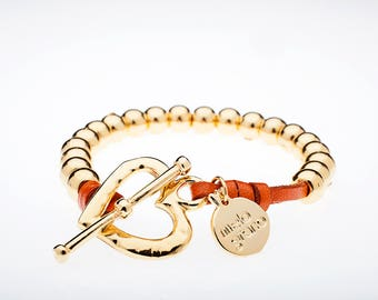 Bracelet with Finish gold spheres and heart clasp. M-130-O