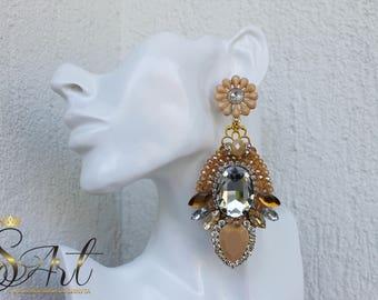 Handmade earrings in beige