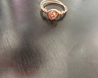 Rose coil ring