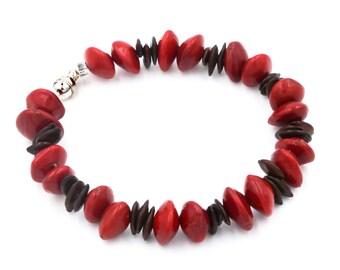 Bracelet seeds red and Leucenes