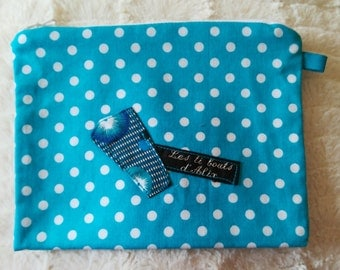 Turquoise pouch with polka dots