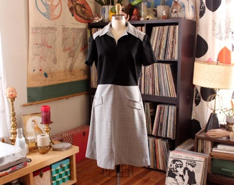 late 1960s waitress dress . black and white scooter dress with front zipper . APPROX womens large xl