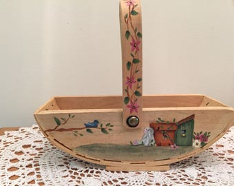 "Basket. Hand Painted, Bunny, Birdhouses, and Birds, 6"" Long 7"" Tall including handle."