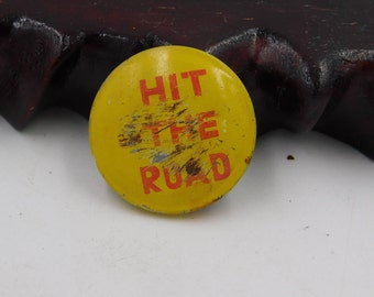 """Vintage Pin Pinback Button That Reads """" Hit The Road """"    DR1"""