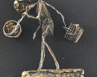 John Flavius & Alfred Weeks  Barbados Sculpture. Metal sculpture man . Wire art.