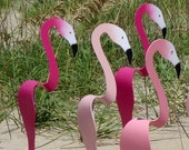 Swirling Pink Flamingos. Kinetic spinners that will bob up and down and twirl with the slightest breeze. Select your favorite shade of pink.
