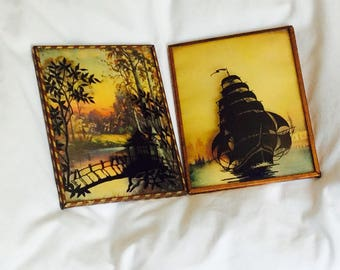 Black Silhouette Reverse Painting Sail Boat House in the Wildwood Concave Glass 1950's Pair