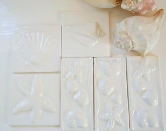 white seashell tiles / set of six  in milky white