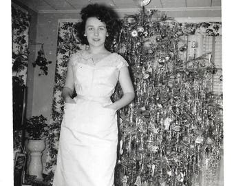 "Vintage Snapshot ""Merry Christmas"" Tall Woman Stands Next To Over-Decorated Christmas Tree Mid-Century Found Vernacular Photo"