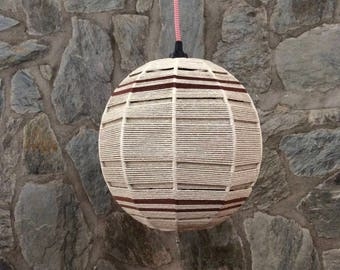 Hand woven beige and brown wool rope ball shaped pendant light. Fabric boho lamp shade.