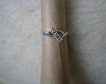 Silver ring with 3 Cubic Zirconias.