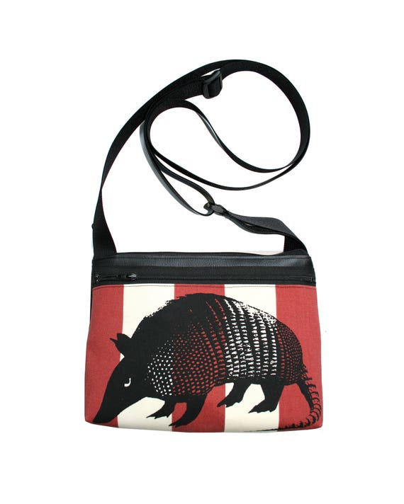 Armadillo, silkscreen, burnt orange, stripes, boxy cross body, vegan leather, zipper top
