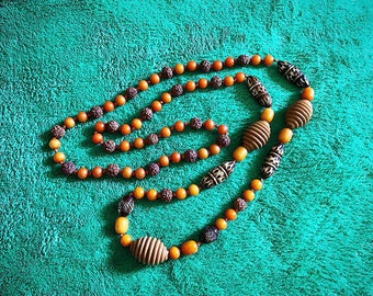 1970s Ethnic Carved Orange Beaded Knotted Necklace