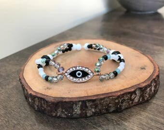 Third Eye Bracelet, shimmering white black and green beads with rose gold third eye