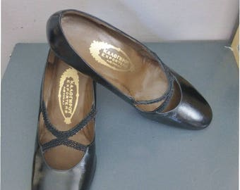 70s patent leather heels. EU size 37. Black classic heels with two black ribbons at front, made in Greece. In excellent vintage condition.