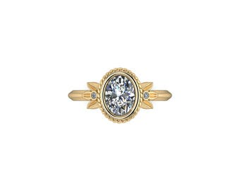 GARLAND: Oval Canadian Diamond Solitaire with leaf and braid accents in your choice of 14k Gold, 18k Gold, or Platinum!
