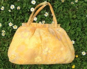 Vintage 1960s, 1970s yellow floral plastic lined make-up bag, wash bag, purse, summer bag