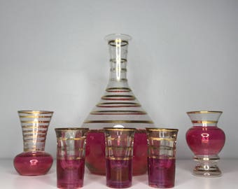 vintage cranberry glass with gold stripes decanter and cordial glasses
