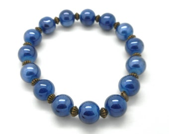 Fancy bracelet blue beads Navy Blue and bronze charms and co.