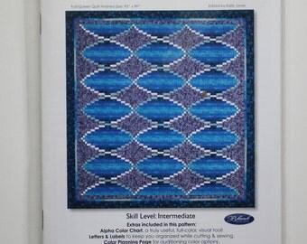 Turn, Turn, Turn:  an inspired spiraling quilt