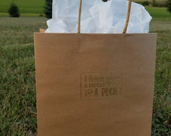"Embossed ""I love you a bushel and a peck"" brown paper gift bag with handles"