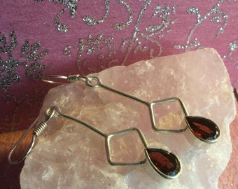 Handcrafted 925 Sterling Silver Earrings featuring faceted Garnet Gemstores