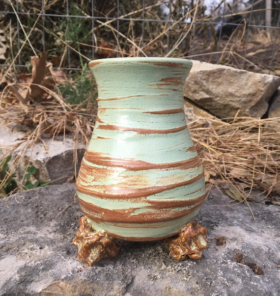 small ceramic vase in pale green and warm brown