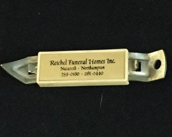 Funeral Home Advertising, Bottle Opener/Can Opener/Magnet, Reichel Funeral Home