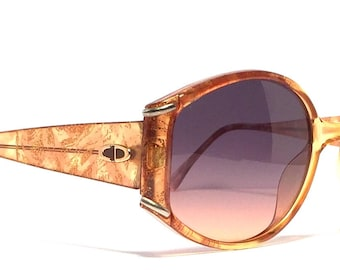 Vintage sunglasses Christian Dior. Made in Austria 1980's. Beautiful color with gold flecks. Excellent quality condition! Exceptional style!