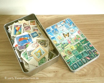 Happy Valley Stamp Art Tin Full of Postage Stamps on Paper